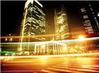 灯光穿梭的都市高楼夜晚繁华图片