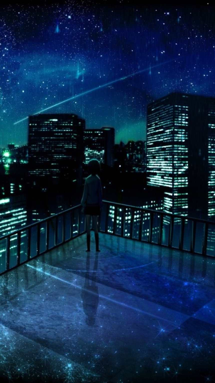 夜晚一个人站在楼顶城市美景孤独(点击浏览下一张趣图)