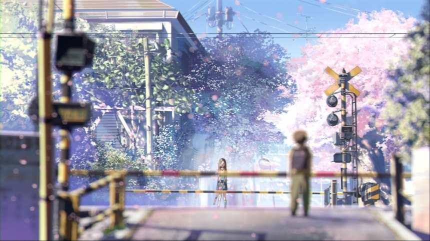 穿过城市的铁轨樱花环绕男生女生对视(点击浏览下一张趣图)